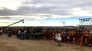 The audience gathers for the concert on the grasslands.