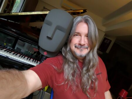 Matthew Lien at home with his C7 piano.